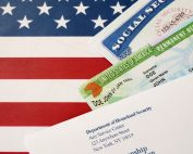 United states permanent resident green card from dv-lottery with social security number lies with USCIS envelope on US flag News News united states permanent resident green card from d 3HKSWBP 177x142