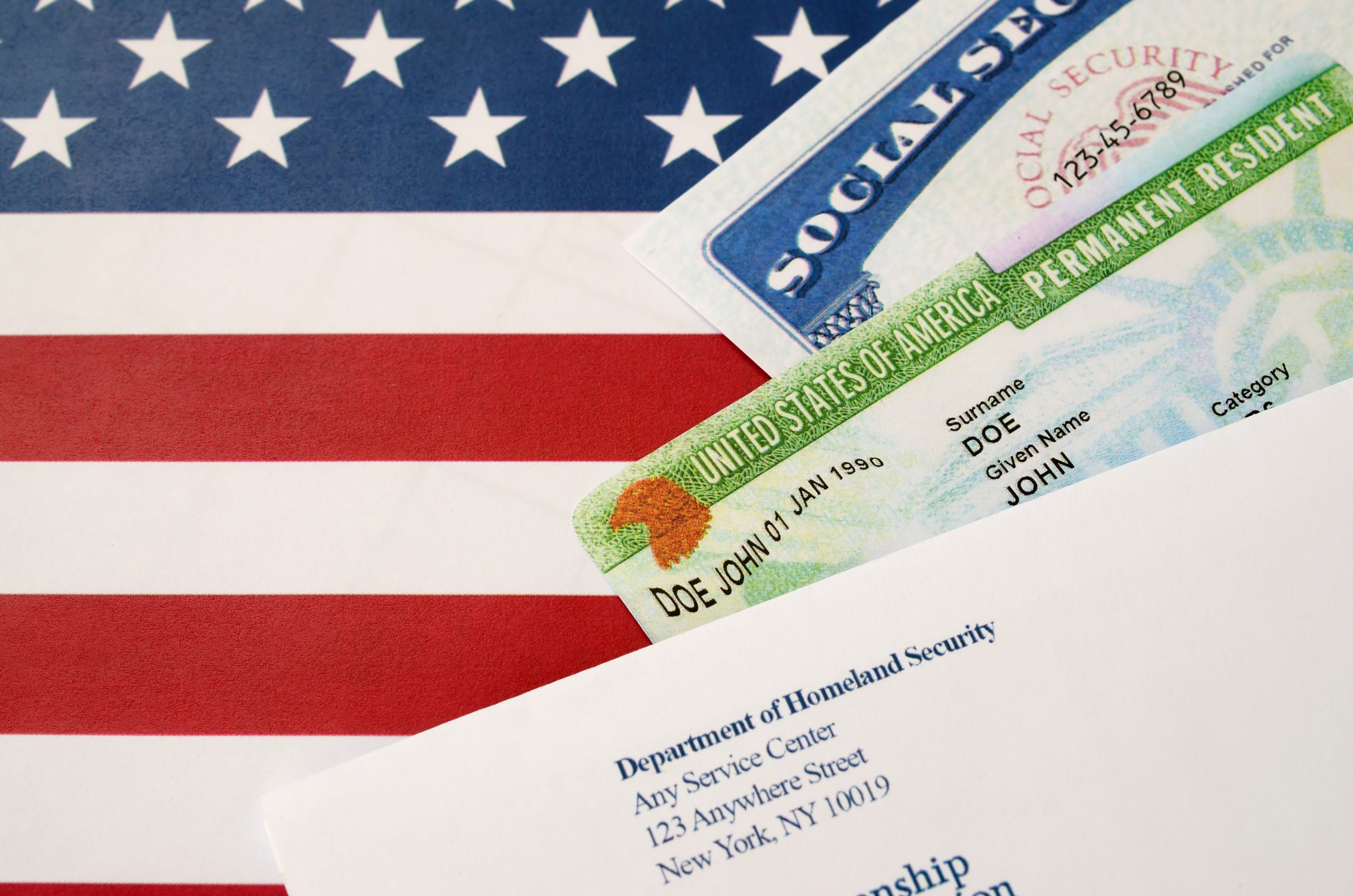 United states permanent resident green card from dv-lottery with social security number lies with USCIS envelope on US flag  7 U.S. Immigration Issues in 2021 and How A Lawyer Can Help united states permanent resident green card from d 3HKSWBP scaled